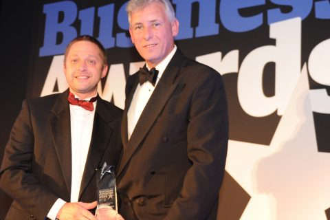 Jason Whittleton (left) of East of England Co-op receives the Food and Farming Excellence award from Chris Bushby of Suffolk Agricultural Association