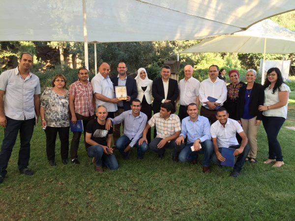 Wafa Ibn Beri with staff at The Tent