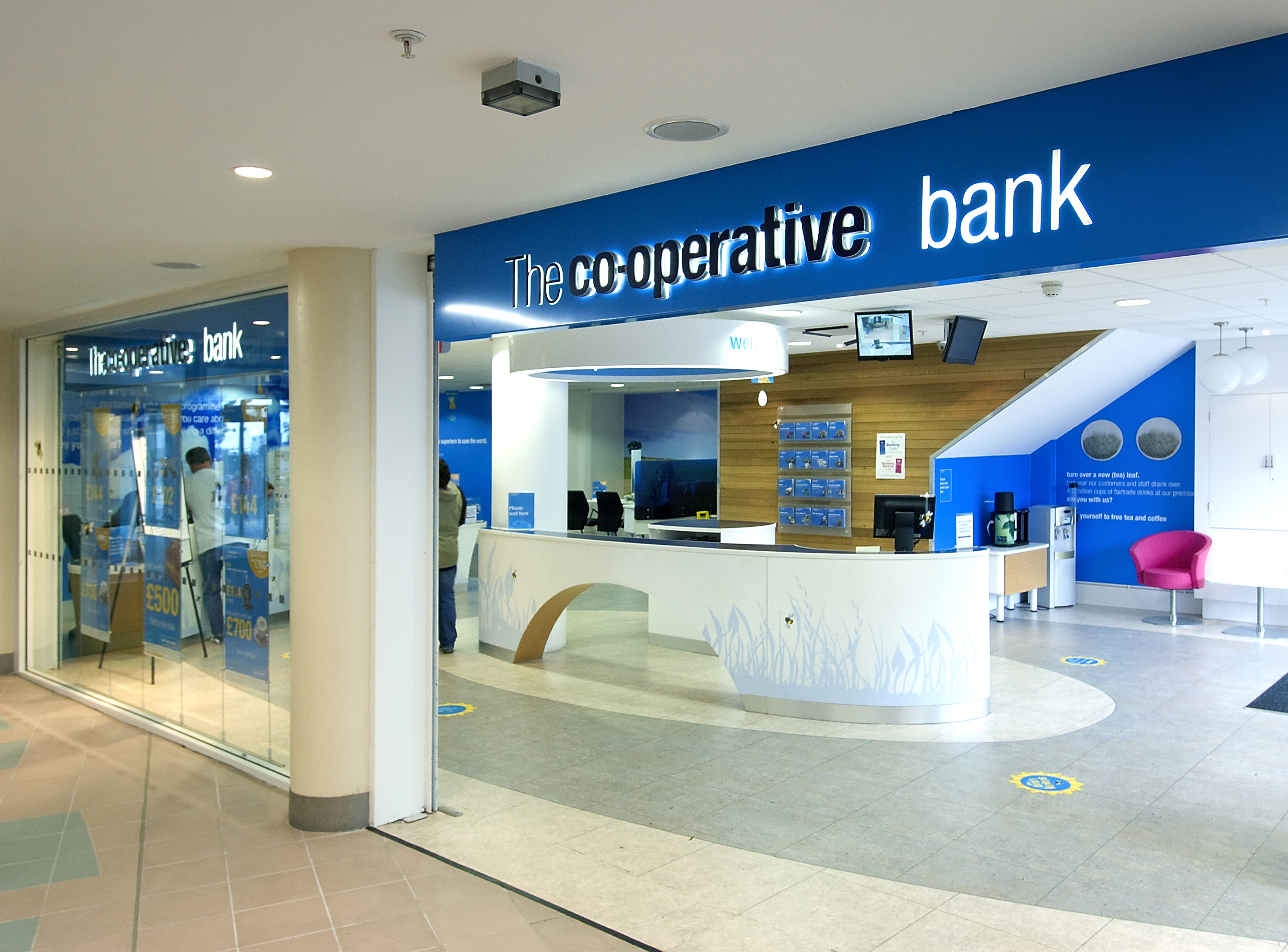 Co op bank reports 477m loss and warns of more branch for The interior company