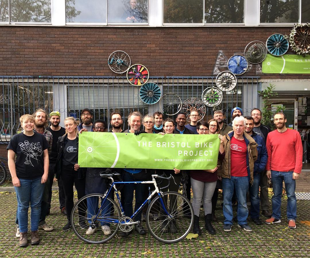 A picture of the Bristol Bike Project team outside the shop