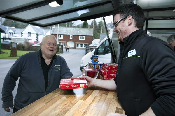 Mayor of Appleby Hughie Potts is served by Co-op manager Ian Peacock at the pop-up store in Appleby in Westmorland, Cumbria