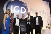 Event host and TV presenter Fiona Bruce presents the IGD Business Transformation Award with Matt Clarke (far right), KPMG, to the Co-op Group's Katie West, project manager, transformation; John McNeil, divisional managing director; Jane McCall, transformation and change director; and Adam Roche, food transformation programme manager