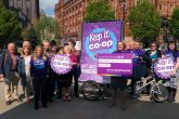The Co-operative Party's 'Keep it Co-op' campaign team celebrate outside the Co-operative Group's annual meeting