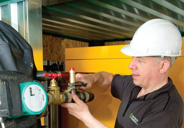 Chris O'Connor, technical director at Biomass, installing a boiler described as 'game-changing heating technology'