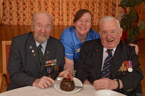 Bob Ryder, 93 (left) and Malcolm Sutcliffe, 92 (right) are with care assistant Dawn Taylor from the Royal British Legion's Lister House in Ripon, North Yorkshire. Bob was a Royal Marine who served on board HMS Renown guarding the Atlantic convoys with Malcolm serving as a wireless operator on board HMS Bleasdale.
