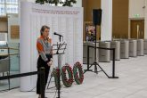 Co-op colleague reading names of WWI victims