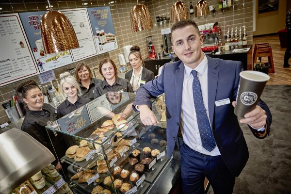 Midcounties store manager Oliver Holden with staff at the new instore Coffee Republic