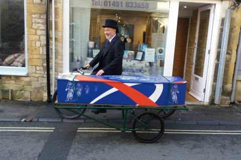The Tour de Britain coffin on display outside the Midcounties Funeralcare branch in Stow-on-the-Wold, Cheltenham