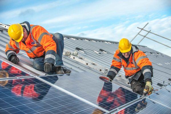 Solar panels being installed at Easton Community Centre, Bristol