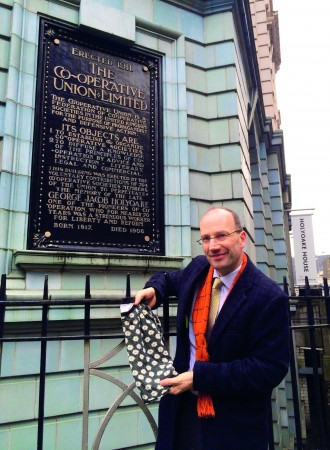 Ed Mayo, secretary general of Co-operatives UK, outside the organisation's head office with an item of clothing from Urban Outfitters' 'Cooperative' clothing line.