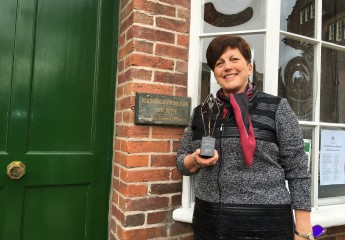 Dame Pauline Green with the Rochdale Pioneers Award in front of the Rochdale Pioneers Museum on Toad Lane.