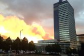 The top floor of the Hanover Building, behind the CIS Tower, Manchester, is being tackled by firefighters