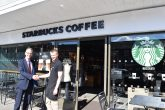 The Southern Co-operative's chief executive Mark Smith with the manager of Starbucks, London Rd, Southampton. The co-op society has had a partnership with Starbucks since 2013.