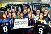 Scotmid staff celebrate breaking the £150,000 barrier for Prostate Cancer UK at their Edinburgh HQ