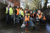 Midcounties Co-operative employees (including sustainability manager Mike Pickering, front right) demonstrate their commitment to sustainability through tackling pollution
