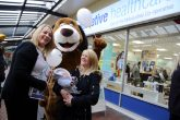 Natalie Brant of The Co-operative Healthcare, greets families at the new Co-operative Healthcare branch