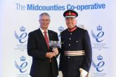 Timothy Cox, the Lord-Lieutenant for the County of Warwickshire, presents a crystal bowl marking the Queen's Award to Midcounties Co-operative chief executive Ben Reid