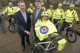 Scotmid chief executive John Brodie and St Andrew's chief executive Stuart Callison with volunteers and the new bikes (Photo: Phil Wilkinson)