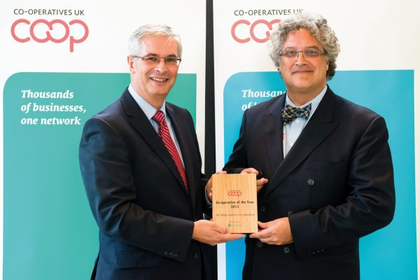 Stéphane Bertrand of Desjardins presents Ben Reid (left), CEO of Midcounties, with the Co-operative of the Year 2015 award