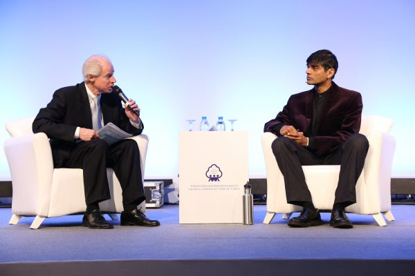Raj Patel talks with Alliance Director-General Charles Gould