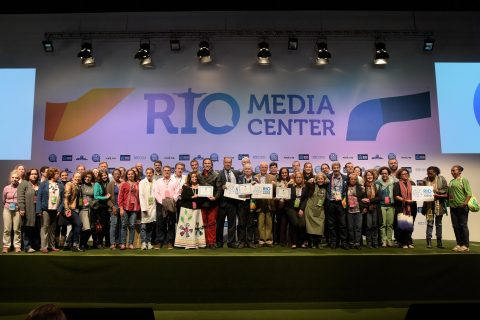 Officials receive the Fair Trade Town certificate during a ceremony in Rio