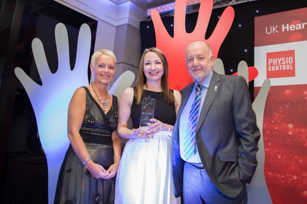 Kath Parr (left) presents the Heart Safe Award to Laura Paterson and Malcolm Brown of Scotmid Co-operative