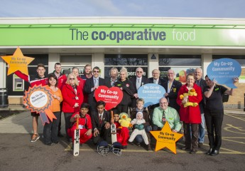 Paul Stilling, manager and colleagues Sophie Higginbottom and Angela Watson from The Co-operative Food, Wigston celebrate with some of the community groups to benefit from the Society's latest round of Community Dividend grants.
