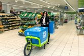 Jo Whitfield, Food CEO at the Co-op Group, with one of the new Home Delivery Bikes at the Chelsea store (Image: Joel Chant)
