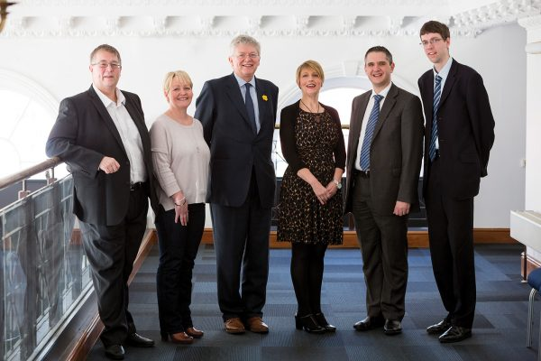 Welsh employee owned companies united: Kevin Edwards of Accommodation Furniture Solutions, Frances Lewis of Aber Instruments, Steven Luke of Arup, Sarah Owens of Wales Co-operative Centre, Ian Urquhart of John Lewis Partnership and David Lowe of Cambrian Printers.