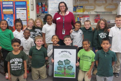 Children at Woodlyn Elementary School in Ridley Township, PA, with Franklin Mint Federal Credit Union community educator Tricia McAllister