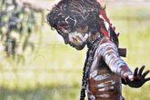 Australian Aboriginal Child with skin painted in the traditional way (Credit: Neftali / Shutterstock.com | Original image: Suzanne Wilson, Wiradjuri photographer)