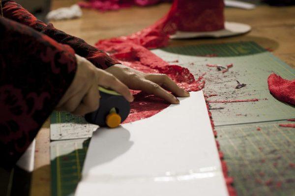 Batol cutting red lace.