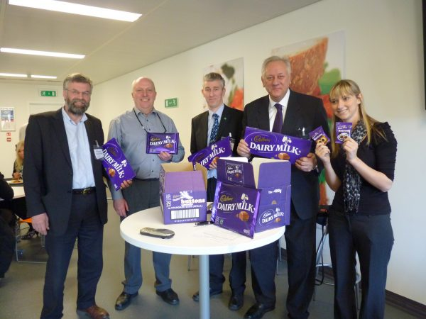 John Boyle, secretary of the Co-op Party (centre) with Paul Birch from Revolver (second from right) in Cadbury's hometown –Bourneville – when the company launched Fairtrade chocolate