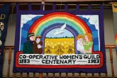 A banner celebrating 100 years of the Co-operative Women's Guild