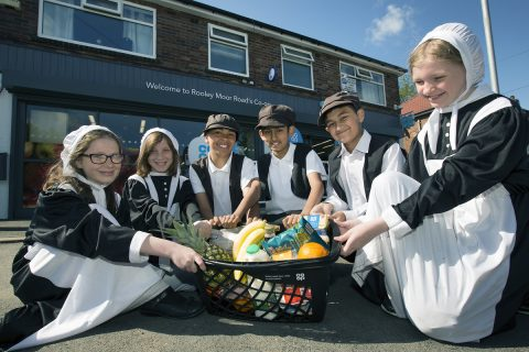 l-r: Sophie Greenwood, Emily Gledhill, Jay Jay Rae, Shazil Tabassun, Junayd Hussain, Jessica Hodgkinson of Meanwood Primary school at the launch of the new Co-op branding in Rochdale [photo: Jon Super]