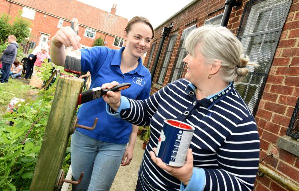 Lincolnshire Co-op painting in Green Synergy Community Garden.