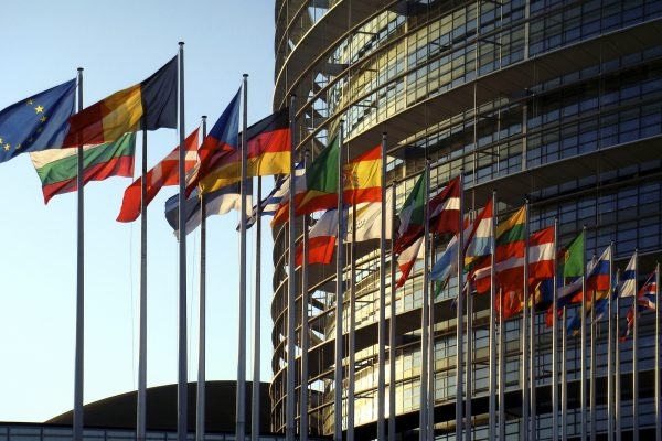 Flags fly at the European Parliament building in Strasbourg