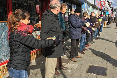 Volunteers move the co-op's stock along a human chain