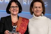 Pippa Wicks, deputy chief executive of the Co-op Group, collects the Stop Slavery Award from Monique Villa, chief executive of the Thomson Reuters Foundation