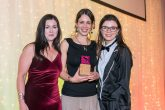 Sally Seddon (centre), Volunteer Engagement Manager at Shared Interest Society, collects the International Impact Award from sponsor Mairi Mackay (left), Global Head for Social Enterprise, British Council, and the award's host comedian and actor Aisling Bea (right)