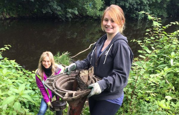 Volunteers and members of Suma Wholefoods co-op clean up River Bank Way in Elland, West Yorkshire.