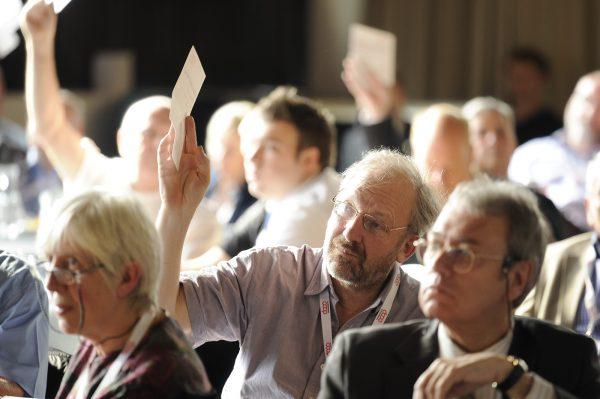 AGM delegates voting. [photo: Co-operatives UK]