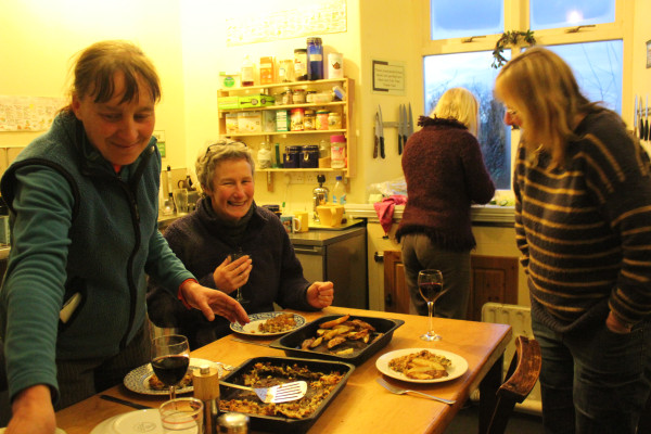 Women staying at the holiday centre sharing a meal.